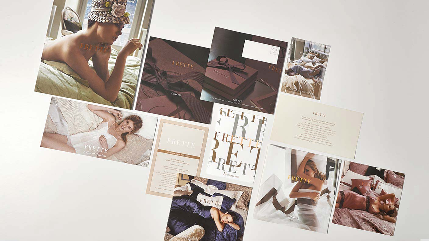 A large number of Frette direct mail pieces and product catalogs against a white background.